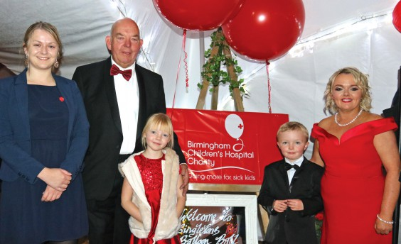 John and Claire Singleton with their children Emily and Jack, and Gemma Hooley of BCH (left).